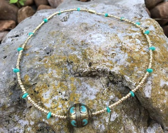 Gold Tone and Turquoise Colored Metal Bead on a Turquoise Colored and Gold Tone Seedbead Necklace