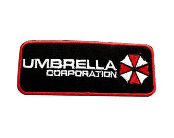 """FREE SHIPPING-Domestic-InspireMeByAudrey Resident Evil Umbrella Corporation Text Embroidered Sew/Iron-on Patch/Applique 3.5"""" X 1.25"""""""