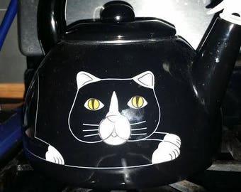Kitschy cat and bird teakettle
