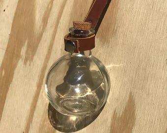 Potion bottle with belt strap