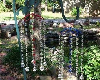 Delight your eyes with this decorative  glass wind chime for your window, door or garden.