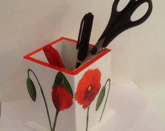 pot pencils or remotes red poppies bloom