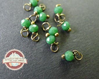 10 round faceted 2x3mm green glass beads