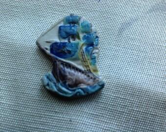 Ceramic cabochon depicting a schooner