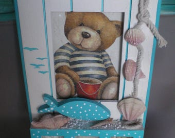 Teddy bear picture frame at the beach blue and white