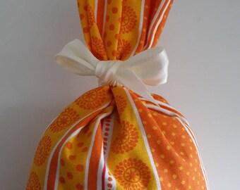 Bag of lavender yellow orange polka dots and stripes patterns
