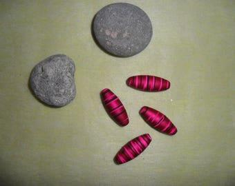 set of 4 black and fuchsia acrylic beads, approximately 3 cm long