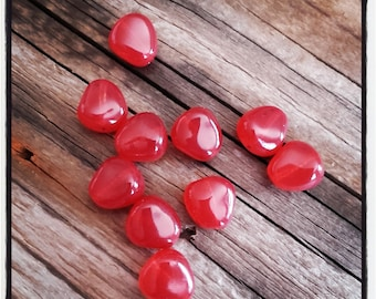set of 10 red glass beads