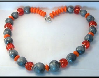 Necklace beads silver polymer clay and orange Crackle glass beads.