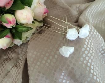 Set of three white satin flower hair pins
