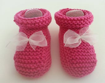Feet hot pink boots accented with a white knot all in transparency