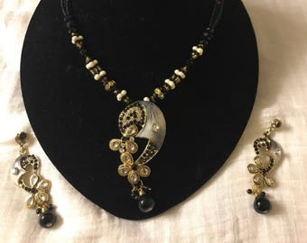 Black beaded necklace set with pendant and earrings