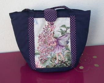Navy blue fabric basket with a pretty fairy