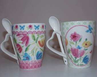 Ceramic mug decorated with flowers with spoon