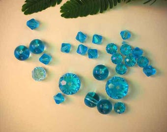 All 26 transparent turquoise blue crystal glass beads with facets, 10x8mm