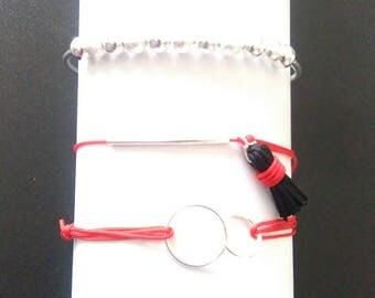 Composition bracelets silver, red and black.