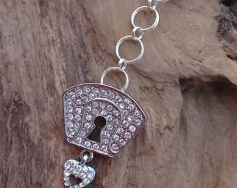Worn silver metal key and rhinestone. Key lock and key