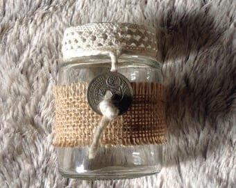 Burlap and lace decorated glass jar