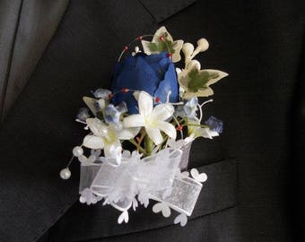 Blue and white flowers wedding boutonniere