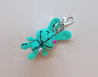 Keychain Vodoo Bunny crocheted in cotton with a hand made on the keychain Locket