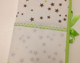 Health book has the cross stitch, stars moles and lime green embroidery