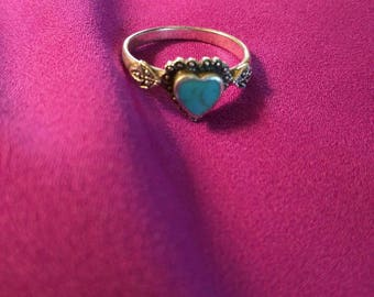Sterling silver heart shaped turquoise ring.