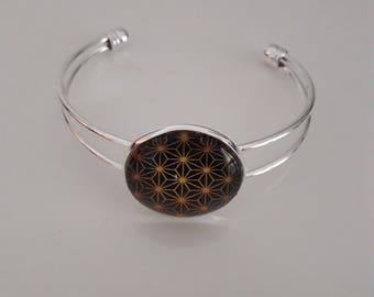 Bracelet with gold and black cabochon