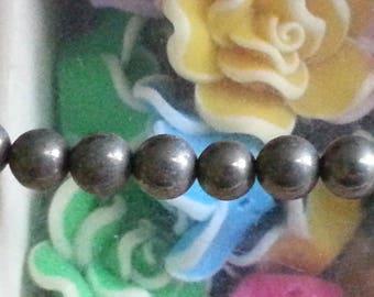 5 6mm pyrite stone bead, hole 1 mm