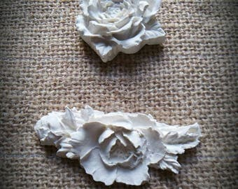 Set of two raw cast roses