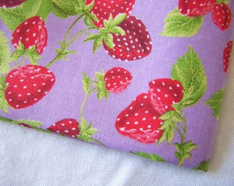 Fabric, cotton, strawberries on purple background