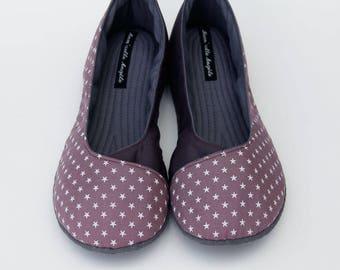 Plum and eggplant crossed ballerinas slippers.