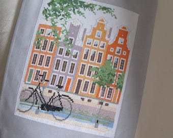 Gray cover and embroidery of a street in Antwerp