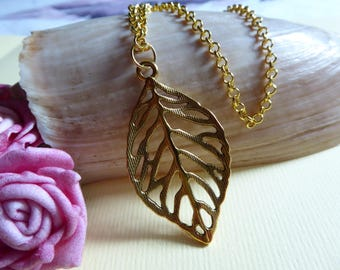 chain gold tone leaf motif pendant