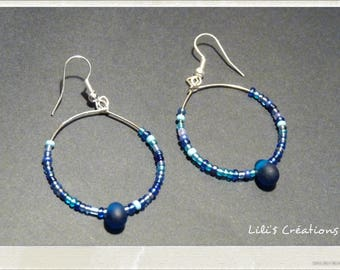 Rings and blue beads earrings