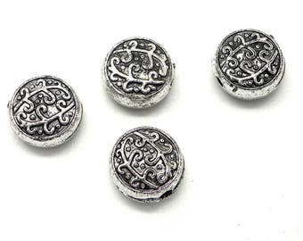 20 small flowered silver beads (ccb)