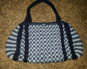 Crocheted lined handbag in blues with button closure