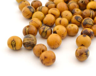 10 yellow round beads 6-10mm Acai seeds