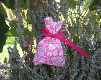 Pink and white pouch bag