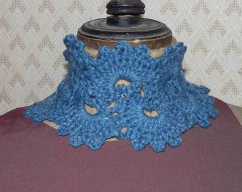 scarf around neck, tied at the back, big crochet lace