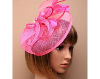 Large looped sinamay hatinator on a clip.pink Ideal for special occasions such as weddings and Ladies races.