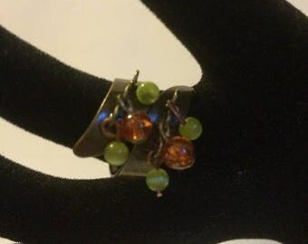 Bronze Adjustable ring with orange and green Crackle glass beads
