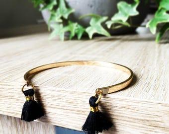 Gold Bangle and its black tassels