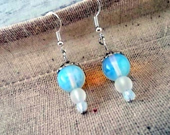 "jewelry designer, ""frosted"" loops, semi-opaque opals, clear frosted glass, faceted Opal"