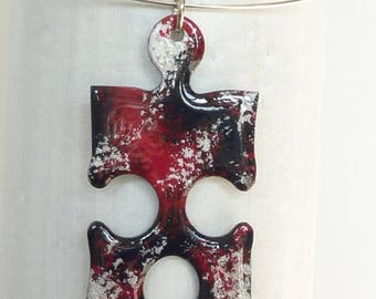 Cardboard, red, black and silver puzzle pendant
