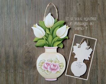 Bouquet of three white tulips in a porcelain vase