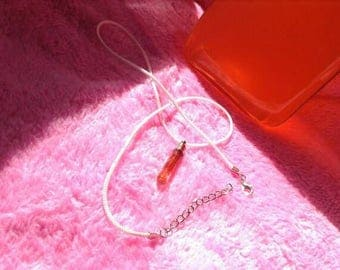 necklace rope with little bottle blood