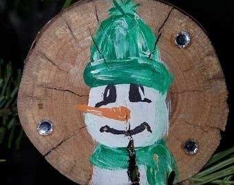 handpainted snowman on hardwood slice