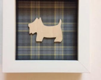 Wooden Scottie Dog on Tartan Background