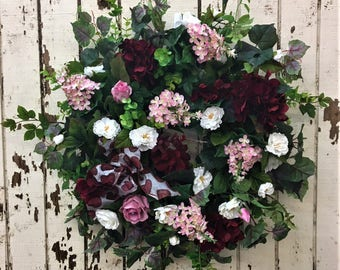 Valentine's Wreath with Pink Lillacs, Burgundy Hydrangea, White Mini Rose, Green Eucalyptus, Dark Pink Roses and a Heart Print Bow
