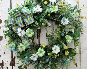 Go Wild for this Spring Wreath with Green, White/Turquoise Daises and Wildflowers with a Blue and Yellow Strip Bow